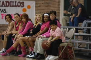 """The Hot Flashes"" team and Coach Paul await the game's start. Photo courtesy of Vertical Entertainment."