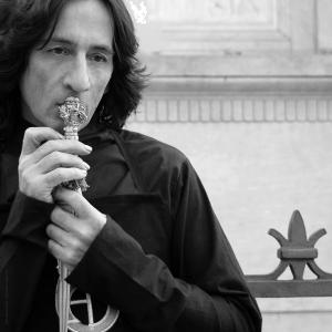 Alessandro Dari holds a sword designed to honor the practice of alchemy. Photo courtesy of Alessandro Dari.